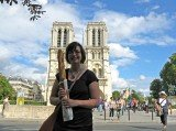 Shanna and the baguette in front of Notre Dame