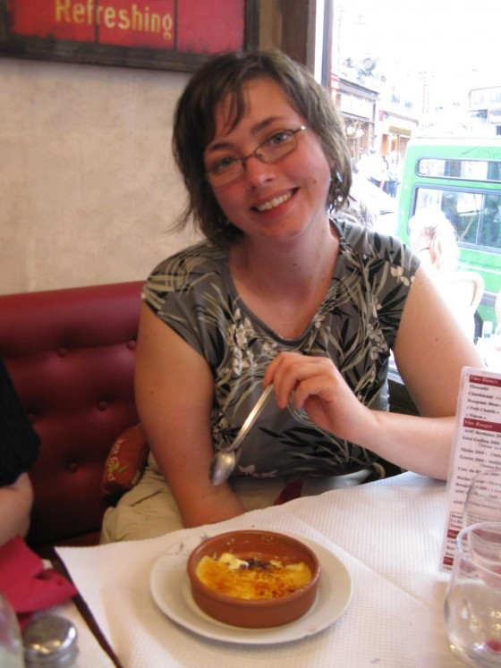 Shanna eating Creme Brulee when we splurged for a nice meal in a french cafe.