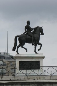 A statue of Henry IV next to the Pont Neuf Bridge
