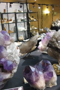 A table full of various crystals at the Tucson Gem Show