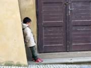A pouty little boy in Prague.