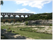 Families picnicking at the Pont du Gard Aqueduct