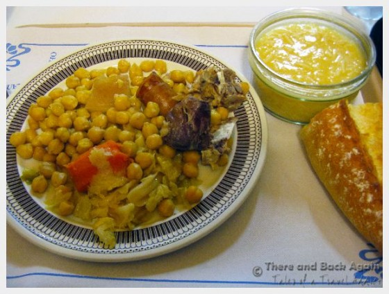 This was my Cocido (a typical, Spanish dish), The bowl of broth was on the right, and the plate in the center of the tray had the ingredients for my stew (chickpeas, pork roast, chorizo sausage, carrot and cabbage) that I could mix into the broth in whatever proportions I wanted.